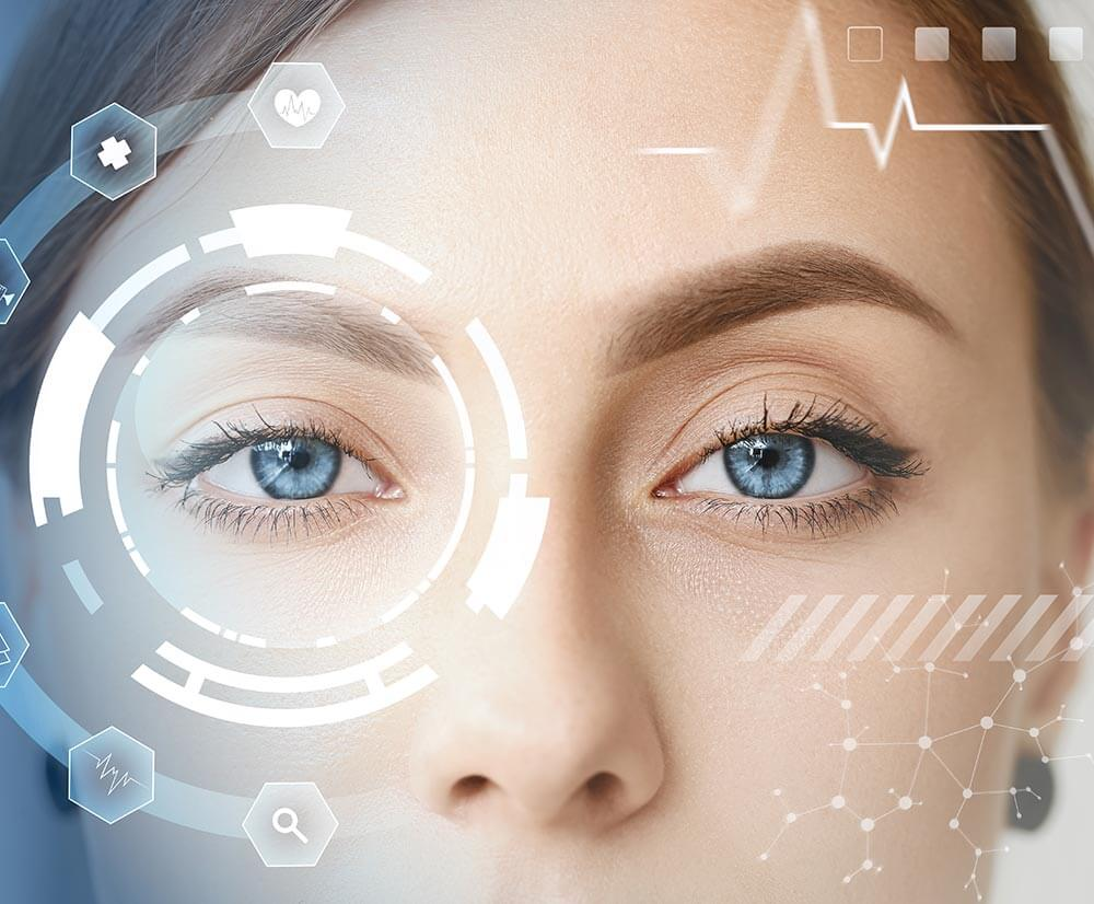 Woman with blue eyes has futuristic graphics on her face