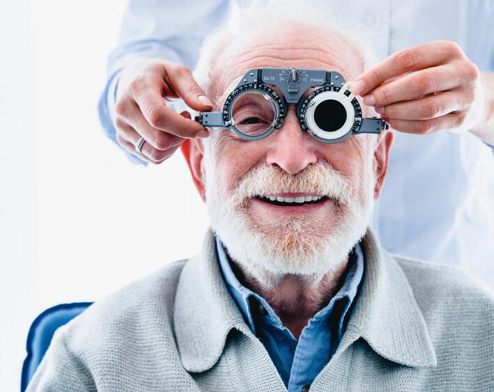Smiling older man having a cataract exam