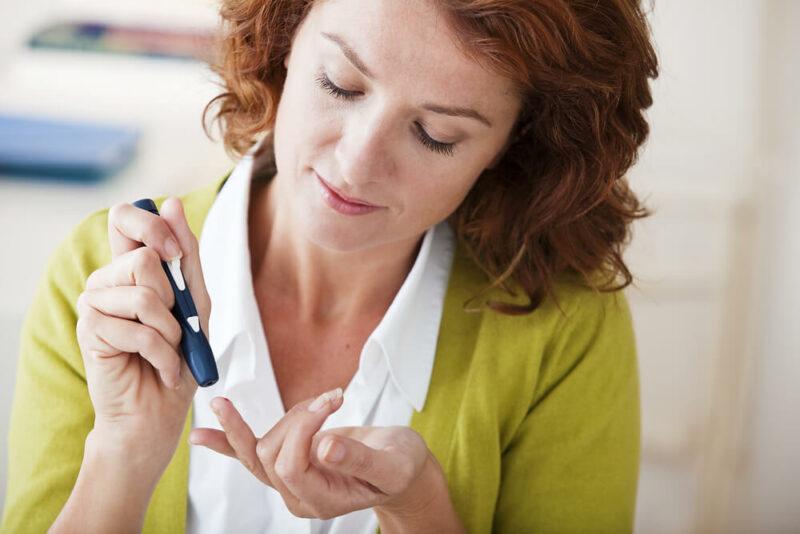 Woman taking a diabetes test