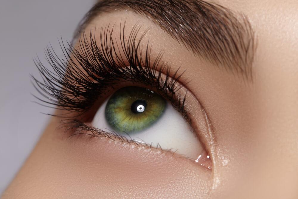 Beautiful macro shot of female eye with extreme long eyelashes and black liner makeup