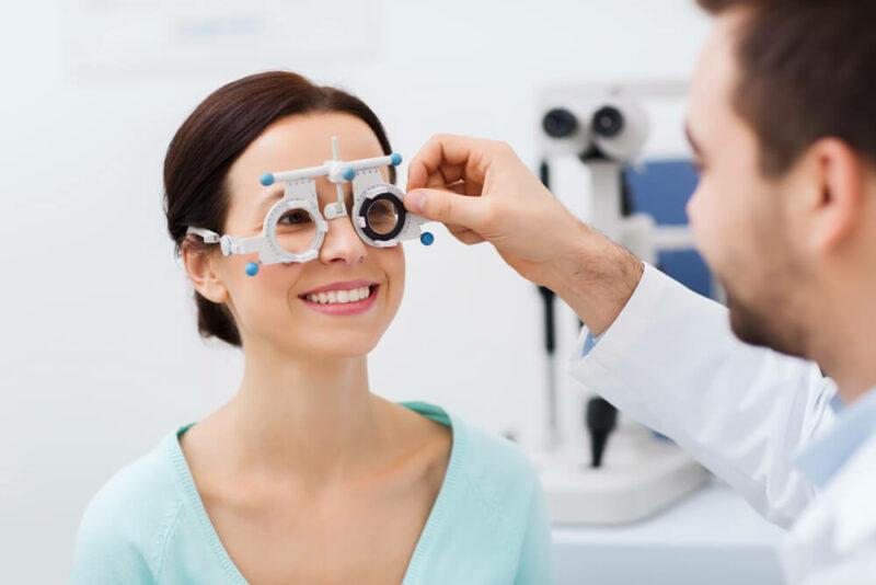 Smiling woman having an eye exam